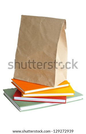 paper bag on notebook color - stock photo