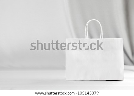 Paper bag on white background. - stock photo