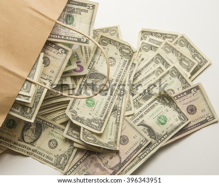 Paper bag with cash/Money /Cash spilling out