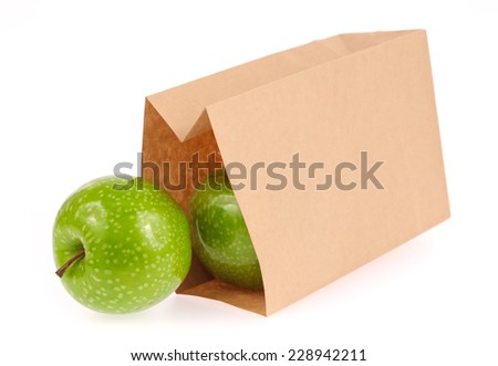 paper bag with green apples isolated on white background