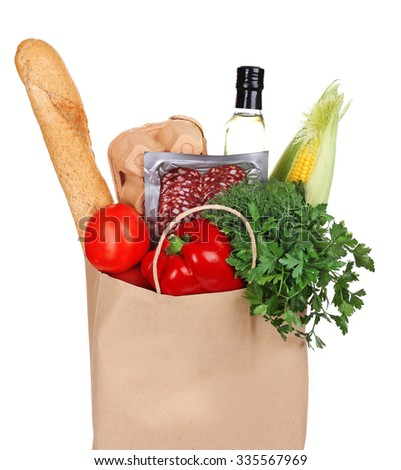 Paper bag with products isolated on white, close up