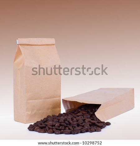 Paper bag with spilled coffee beans - stock photo