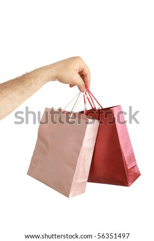 Paper bags in male hand isolated background