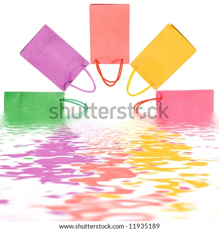 Paper bags in water isolated on white (clipping path) - stock photo