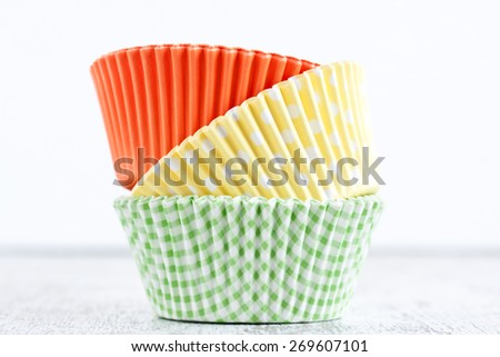 paper baking cups for muffin and cupcakes - stock photo
