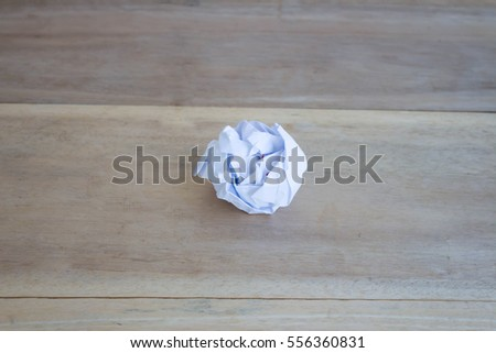 paper ball on the wooden table