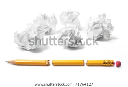 Paper Balls and Broken Pencils on White Background - stock photo
