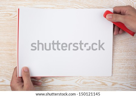 Paper binding on a wooden texture imitating a office desk. - stock photo