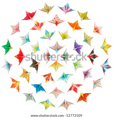 Paper birds arranged in circles and isolated on a white background - stock photo