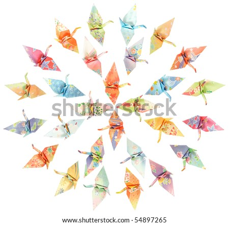 Paper birds arranged in concentric circles and isolated on a white background - stock photo