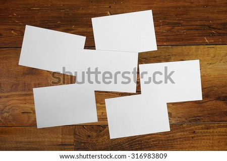 Paper blank photos collage on wooden background. Preparation for a photo collage. Postcard set on the table. - stock photo