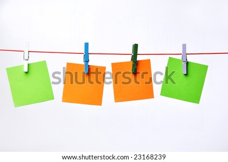 paper Blanks Hanging on a Rope Held By Clothespins