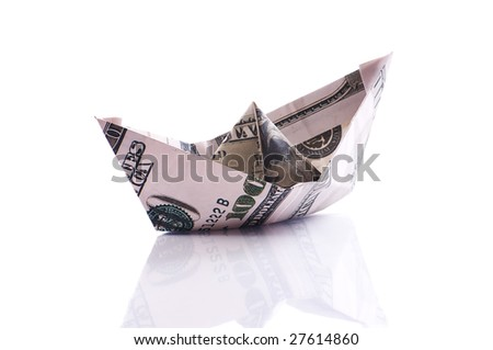 paper boat from dollar banknote on white - stock photo