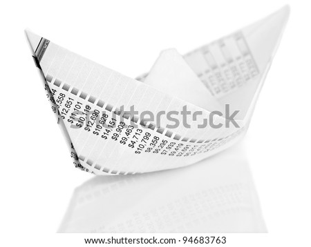 Paper Boat. Origami  paper boat made from financial  document - stock photo
