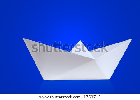 Paper boat with blue background - stock photo