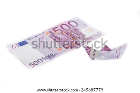 Paper boat with five hundred euros bill  - stock photo