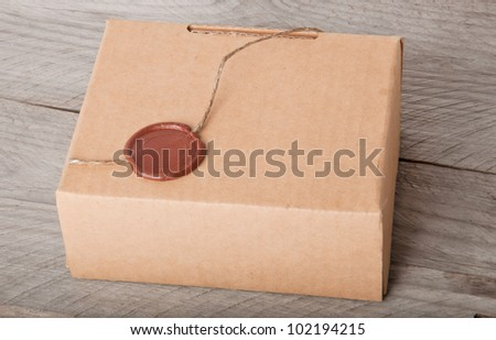 paper box on a wooden background - stock photo