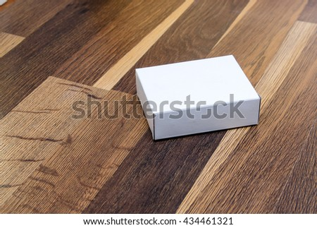 paper box on wooden background