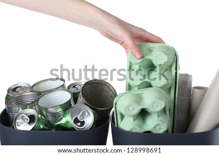 Paper boxes and metal tins prepared for recycling - stock photo