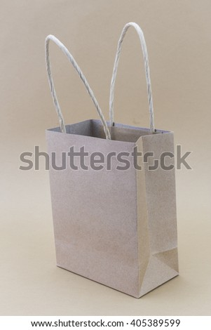 Paper brown shopping bag isolated on brown background - stock photo