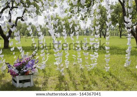 paper butterflies outdoor - stock photo