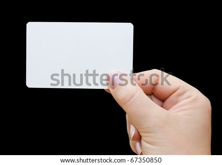 Paper card in woman hand on black background
