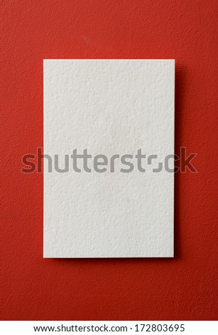 paper card on a red background - stock photo
