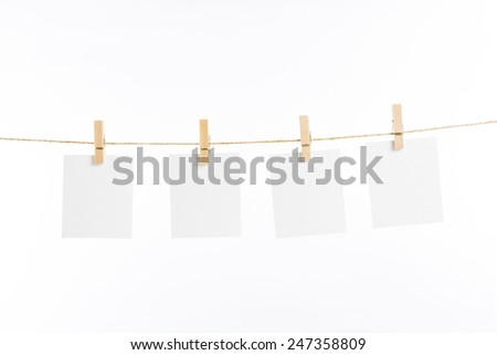 paper cards hanging rope isolated on white background - stock photo