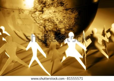 Paper chain and globe - stock photo