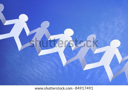Paper chain community with blue sky background concept for teamwork, networking or social media group - stock photo