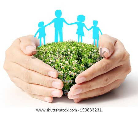paper chain family with the protection of cupped the hands - stock photo