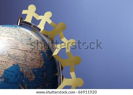 Paper chain hung around the globe. - stock photo