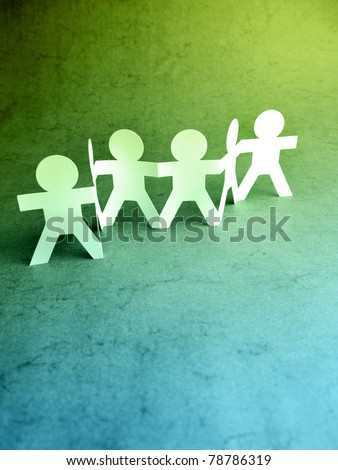 Paper chain people holding hands - stock photo