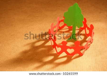 Paper chain people united to save the environment - stock photo