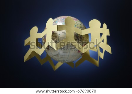 Paper chain surrounding a globe. - stock photo