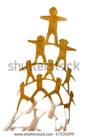 Paper chain team holding hands - stock photo