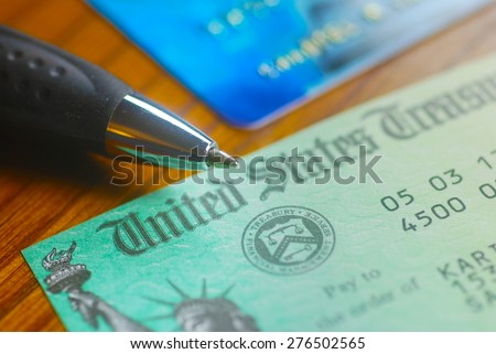 Paper check from the United States Treasury - stock photo