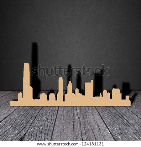Paper city on wood grain with black shadow - stock photo