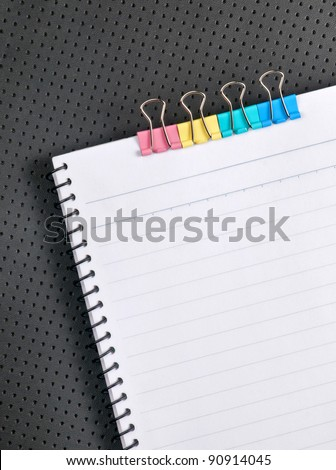 paper clip and notebook on the table