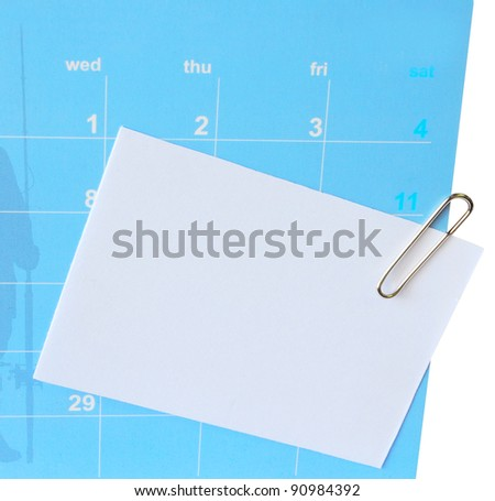 Paper-clip and short letter on  blue calender - stock photo