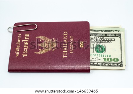 paper clip and us dollar bills with Thailand passport on white background