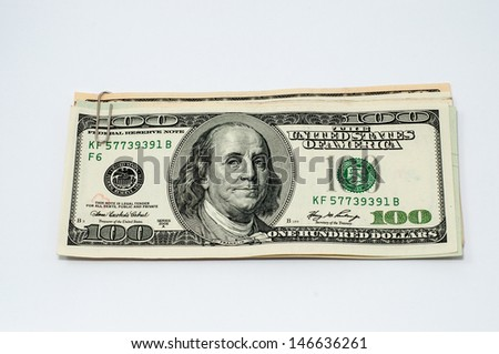 paper clip with dollars on a white background