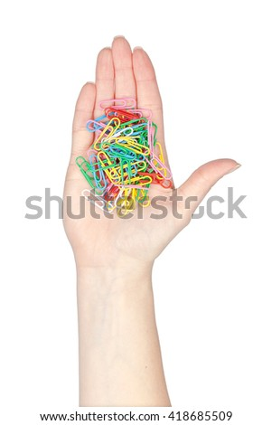 paper clips in a hand isolated on white background. school and office tools. stationery - stock photo