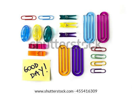 Paper clips set and yellow paper note with the words Good Day isolated over a white background - stock photo