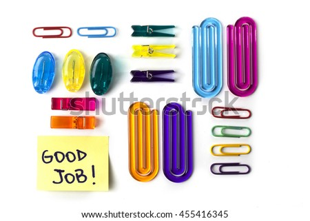 Paper clips set and yellow paper note with the words Good Job isolated over a white background - stock photo