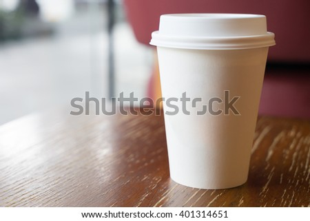 Paper coffee cup on coffee shop