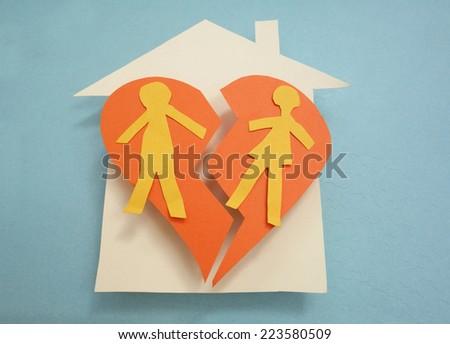 Paper couple on a split house - divorce concept                                - stock photo