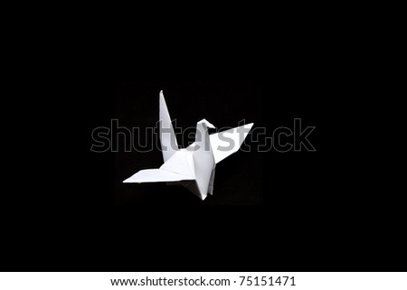 paper crane  isolated on black background - stock photo