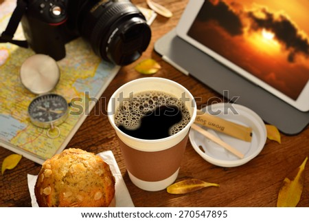 Paper cup of coffee and travel equipment - stock photo