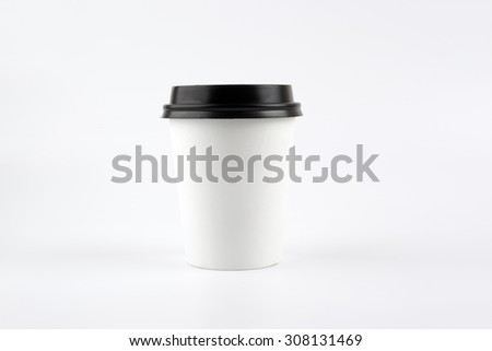 Paper cup of coffee on white background - stock photo